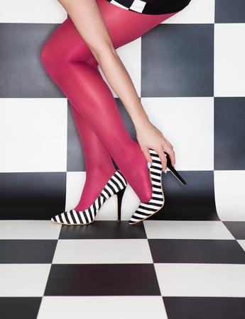 take off: Fashion concept woman wearing high heels stilettos legs close up