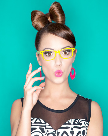 woman wearing glasses: Young attractive fashionable surprised woman wearing glasses