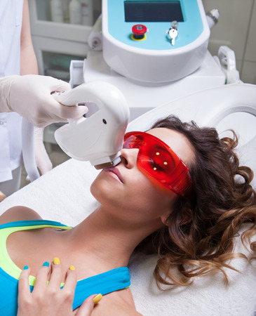 aesthetic: Woman getting laser treatment in medical spa center, permanent hair removal concept