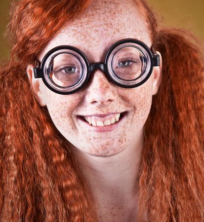 nerdy: Cheerful freckled nerdy girl