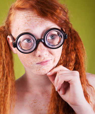 funny nerdy girl looking right Stock Photo