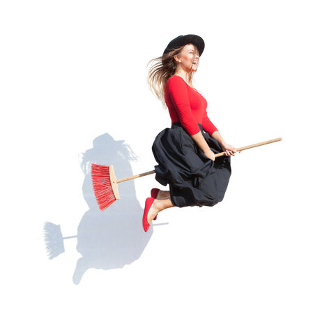 flying woman: Happy young witch flying on a broom, halloween concept Stock Photo