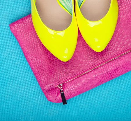 Neon high heels and snakeskin print bag, woman fashion concept Stock Photo