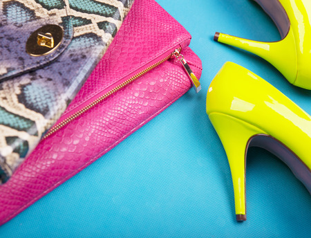 high heel shoes: Neon high heels, and snakeskin print bag, woman fashion concept Stock Photo