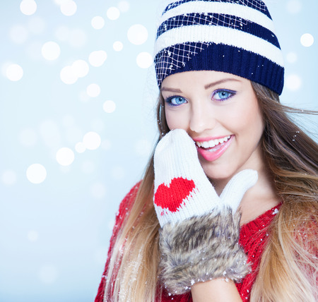 make love: Woman wearing winter clothes covered with snowflakes. Stock Photo