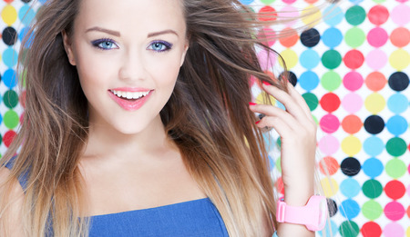 Young woman on spotted background, beauty and fashion concept