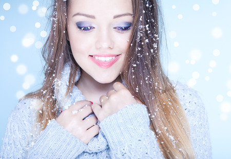 laughing face: Winter face close up of young attractive woman covered with snow flakes. Christmas concept. Stock Photo