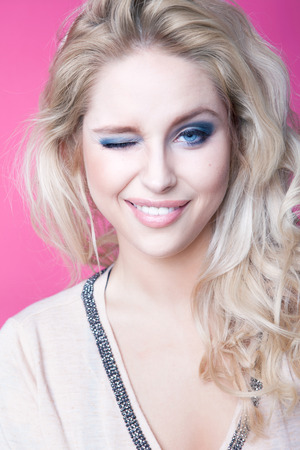 winking: Young attractive blonde winking woman expressive portrait