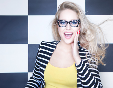 woman wearing glasses: Surprised young woman wearing glasses Stock Photo