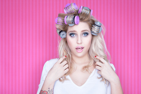 getting ready: Young attractive woman with hair curlers Stock Photo