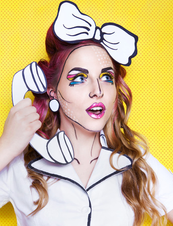 calling art: Woman with cartoon pop art make up and phone