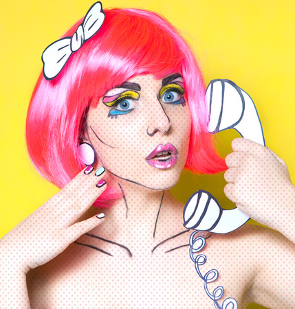 make a call: Surprised young woman with phone and cartoon make up