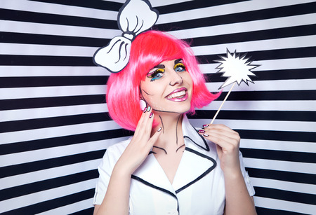 Smiling woman with comic talk bubble and make up photo