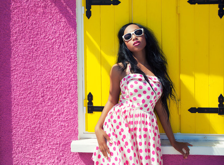 Attractive smiling african american woman wearing sunglasses