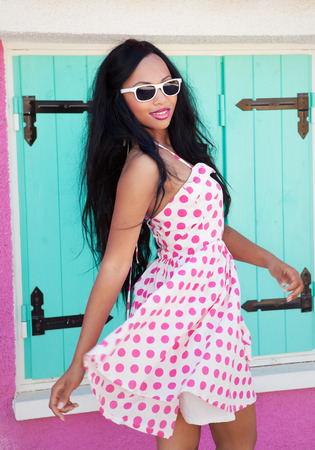 summer dress: Attractive young african american woman wearing sunglasses