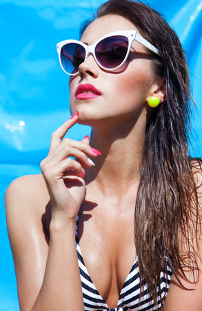 charming: Summer portrait of young attractive woman with sunglasses