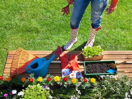 yard: Woman with gardening tools, flowers and pots