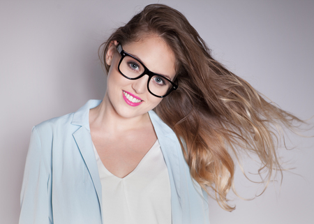 woman  glasses: Young attractive laughing blonde smart happy business woman wearing glasses expressive portrait beauty concept