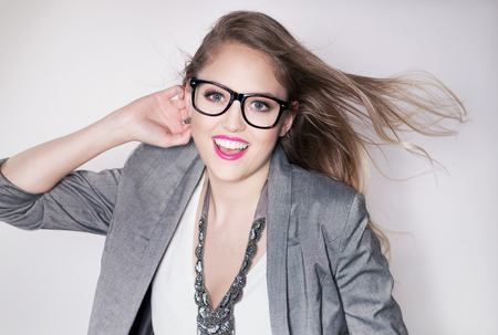 glasses model: Young attractive laughing blonde smart happy business woman wearing glasses expressive portrait beauty concept