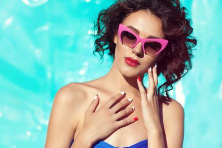 Summer beach style portrait a beautiful young woman wearing bikini and sunglasses