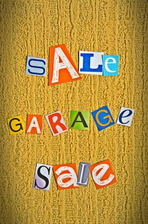 announcement of a garage sale is composed of letters cut photo