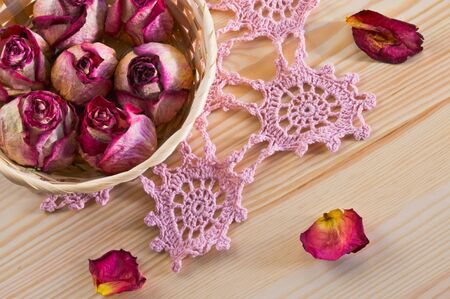 wizened: lovely dried roses on the table with light wood