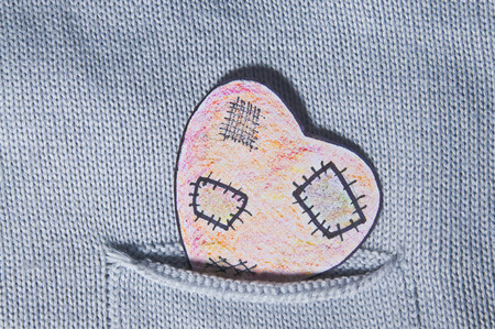 painted heart paper in a pocket knit cardigan