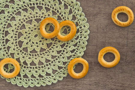 lace doily: traditional bagels and lace doily on a wooden table
