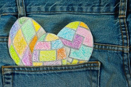 jeans pocket: painted colorful Easter eggs in a jeans pocket.