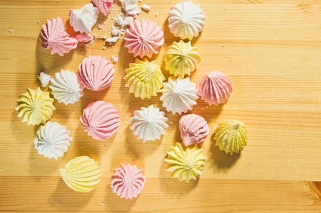 kiss biscuits: traditional French pastries meringue on wooden table Stock Photo