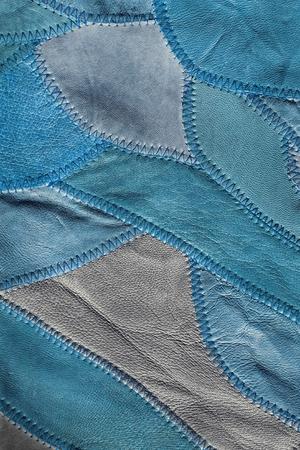 patchwork background: Blue patchwork background of genuine leather Stock Photo