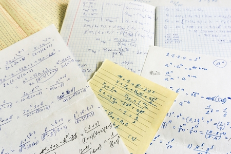 old sheets of paper with mathematical and mathematical calculations