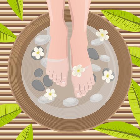 beautiful feet: Female feet at spa pedicure procedure. Legs, flowers and ceramic bowl.