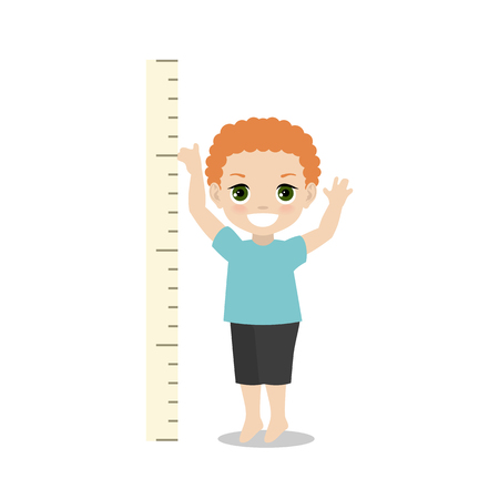 Kid measures the growth. Boy is measuring his height.