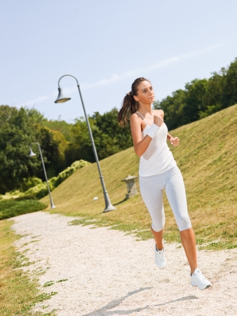 Young woman jogging photo