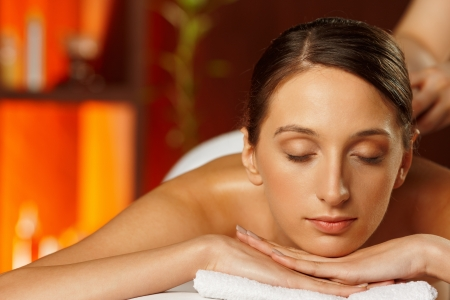 closed eye: Spa stones therapy Stock Photo