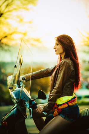 Young beautiful woman on motorcycle photo