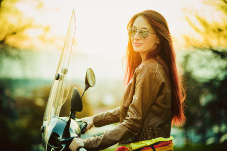 Young beautiful woman on motorcycle Standard-Bild