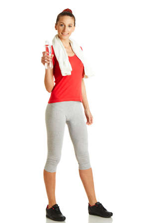 Young fitness woman holding bottle of water
