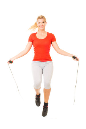 Woman exercising fitness jumping rope in  Stock Photo
