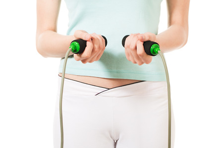 Woman holding jump rope Stock Photo