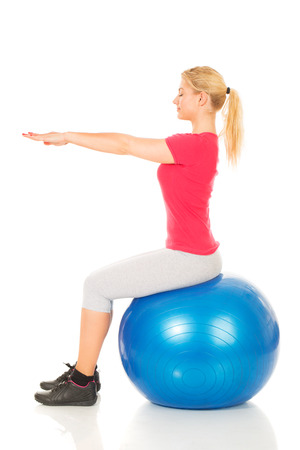 Fitness woman sitting on pilates ball  Stock Photo