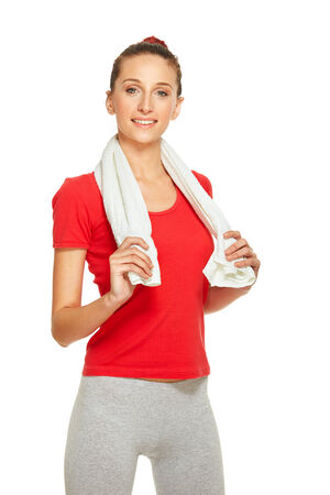 Young fitness woman with towel around neck