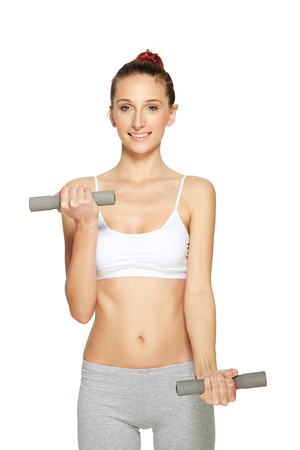 dumb: fitness woman working out with dumbbells Stock Photo