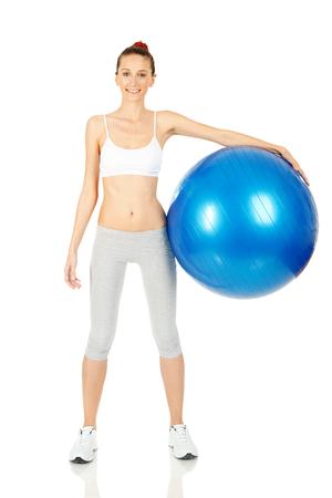 Fitness girl holding pilates ball
