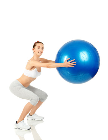 Fitness girl working with pilates ball Stock Photo