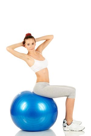 Fitness girl working on pilates ball