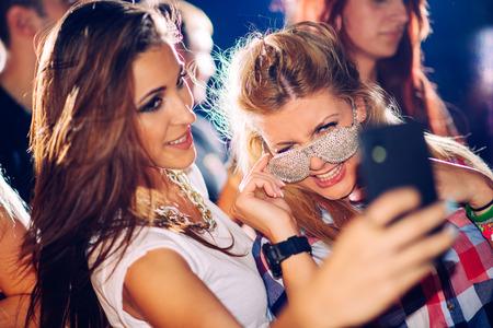 clubbing: Party people taking selfie