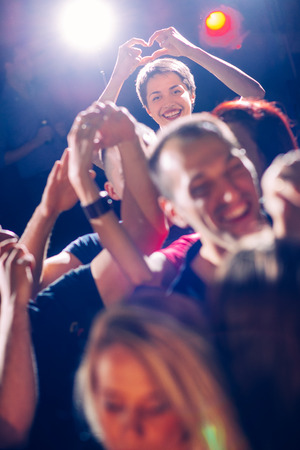 Party people showing heart shape Stock Photo