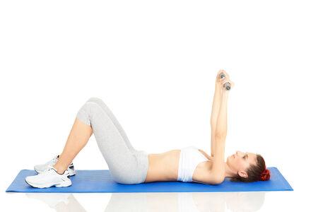 Young woman exercising on mat
